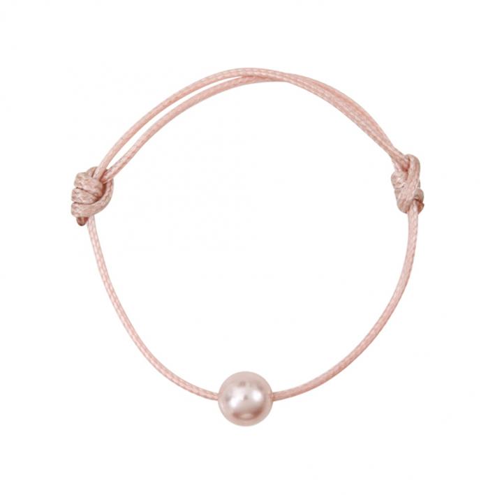 Bracelet une perle nacre rose sur coton ciré rose